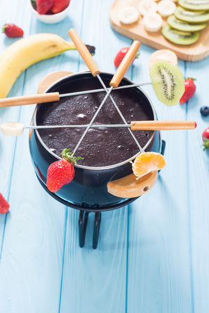Dessert . Chocolate fondue whith fruit and berries . Food background Archivio Fotografico