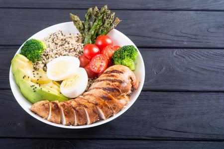 Buddha bowl salad with quinoa eggs avocado chicken and tomatoes . Healthy detox food Stock Photo
