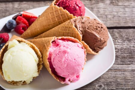 Ice cream waffle cones with berries , chocolate and vanilla Banco de Imagens