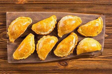 Latin American baked beef empanadas with sauces . Food background Banco de Imagens