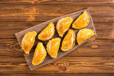 Latin American baked beef empanadas with sauces . Food background Stok Fotoğraf