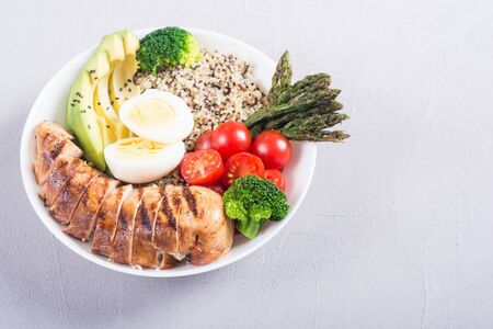 Buddha bowl salad with quinoa eggs avocado chicken and tomatoes . Yealthy detox food Foto de archivo