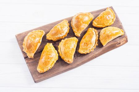 Latin American baked beef empanadas with sauces . Food background Stock Photo