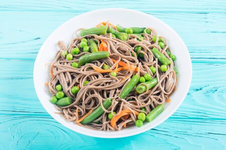 Soba noodles salad . Asian food background . Japanese bowl Banco de Imagens