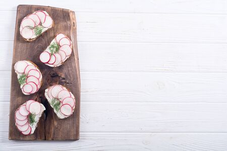Healthy vegetable toasts sandwich with radish and dill . Food background