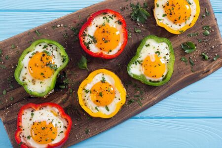 Yellow, red and green pepper with fried eggs. Colorful healthy breakfast Stock Photo