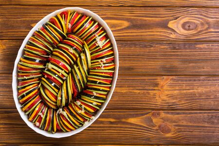 Raw traditional French vegaterian food ratatouille on rustic background Stock Photo