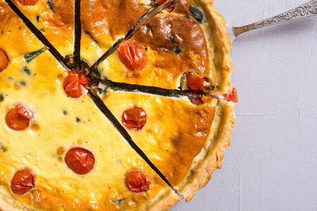Traditional French pie. Spinach Quiche lorraine with tomatoes
