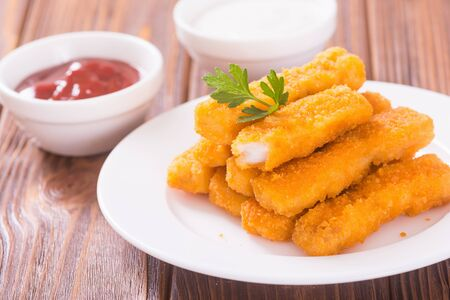 Fried fish sticks (fingers) or chicken nuggets. Snack food
