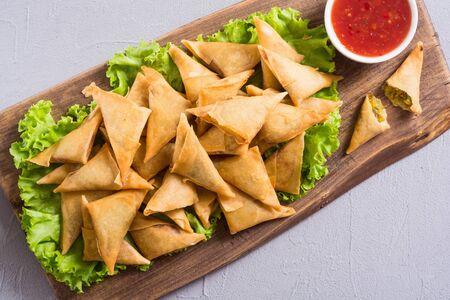 Ramadan iftar meal. Traditional asian vegetarian food - samosa