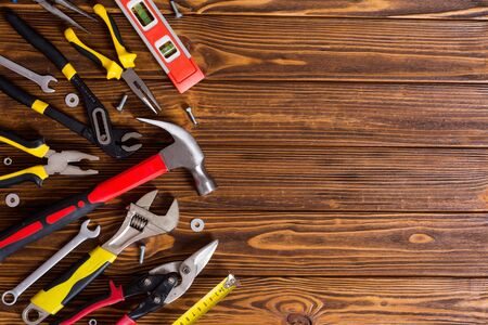 Set of hand tools . Equipment on wooden background