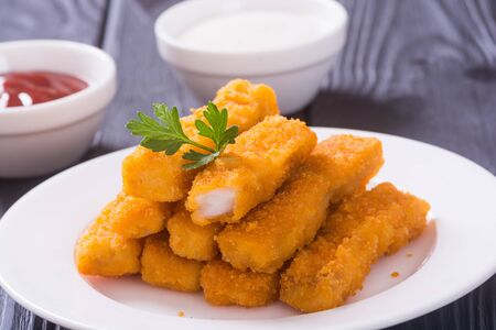 Fried fish sticks ( fingers ) or chicken nuggets . Snack food Stok Fotoğraf