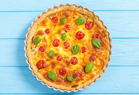 Traditional French pie . Chicken Quiche lorraine with mushrooms , tomatoes and cheese