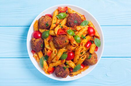 Italian penne pasta with meatballs and tomatoes . Food background Stock fotó