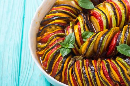 Traditional French cooked provencal vegetable dish - Ratatouille . Food background