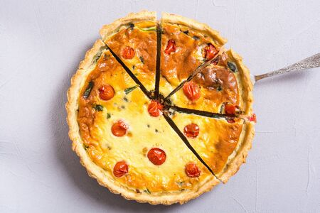 Traditional French pie . Spinach Quiche lorraine with tomatoes Stock fotó