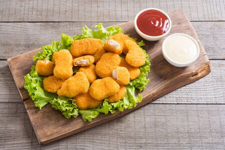 Chicken golden nuggets in plate on rustic background . Unhealthy fast food Stock fotó - 144207080