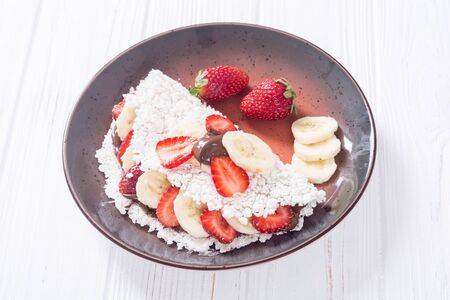 Brazilian breakfast tapioca with strawberry , banana and hazelnut cream Stock fotó