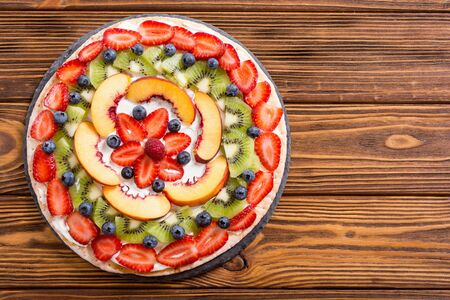 Fruit pizza with fruit and berries . Sweet tasty dessert Stock fotó - 144001445