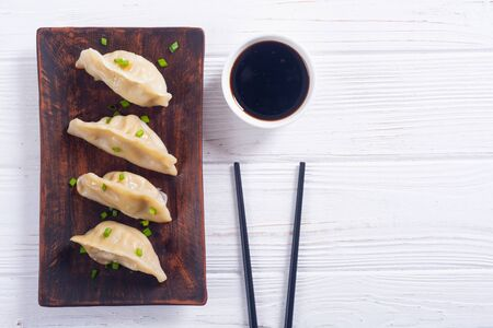 Traditional asian dumplings gyoza with green onion and soy sauce