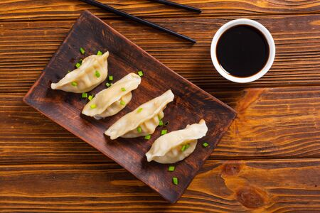 Traditional asian dumplings gyoza with green onion and soy sauce Stock fotó