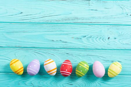 Colorful easter eggs collection on wooden background