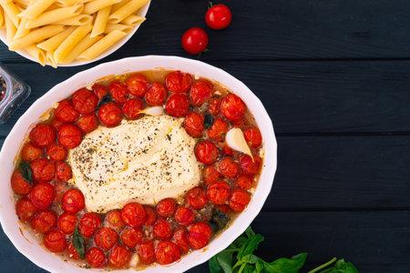 Healthy vegetarian italian baked feta pasta. Food background