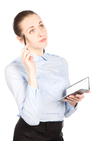 Business woman thinking and holding notebook on her hand photo