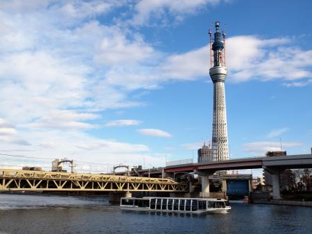 sumida: Pleasure boat on the Sumida River Tokyo Sky Tree under construction Stock Photo