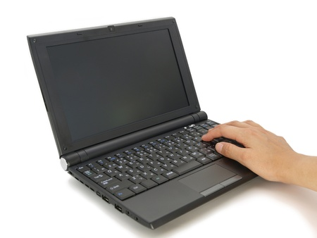 thirtys: Female hand laptop Stock Photo