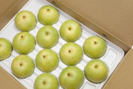 Twentieth century pear-packed in a box photo