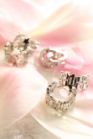 Earrings and petal Stock Photo - 23281722