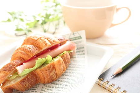 snack time: Snack time croissant Sand Stock Photo