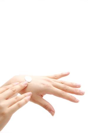 obtaining: I put a hand cream Stock Photo