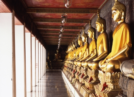 lining up: Buddha statues lining up to a corridor of Wat Suthat