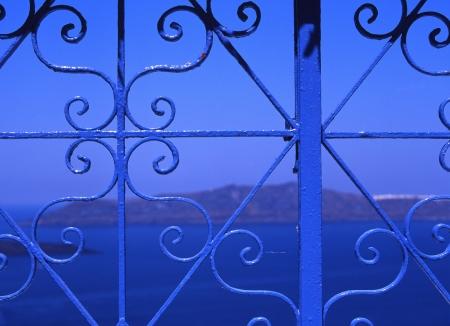 grates: Aegean sea visible beyond the decorative lattice Stock Photo