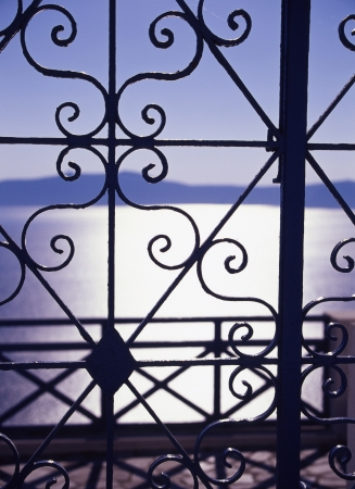 aegean sea: Aegean sea visible beyond the decorative lattice Stock Photo