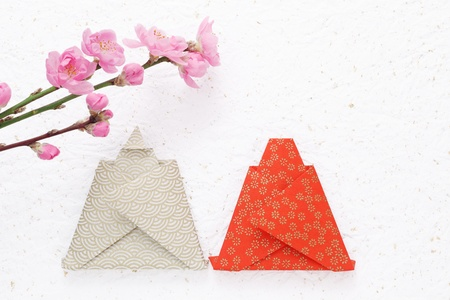 Peach flowers and doll of origami photo