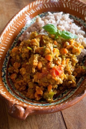 Curry of summer vegetables and minced meat photo