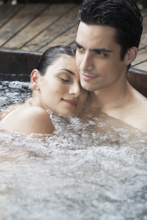 Young couple relaxing in Jacuzzi photo