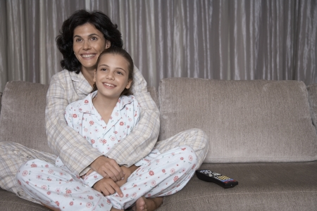 Mother and daughter watching TV photo