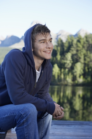 casual hooded top: Teenage boy by lake, Cape Town, South Africa