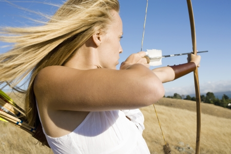 Young woman arrow shooting photo