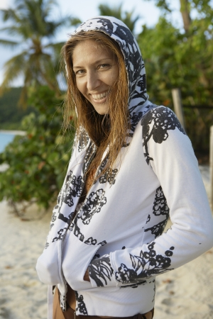 casual hooded top: Mid adult woman in hooded top on beach