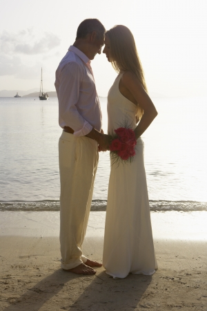 Newlyweds on beach, St. John, US Virgin Islands, USA photo