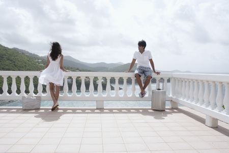 Young couple on balcony at resort, St. John, US Virgin Islands, USA photo