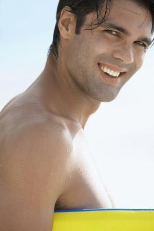 bodyboard: Portrait of young man with bodyboard
