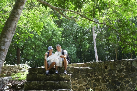 Mid adult couple hiking in old ruins photo