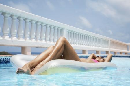 Woman lying on pool raft photo