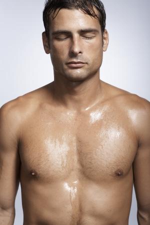 Mid adult man sweating photo